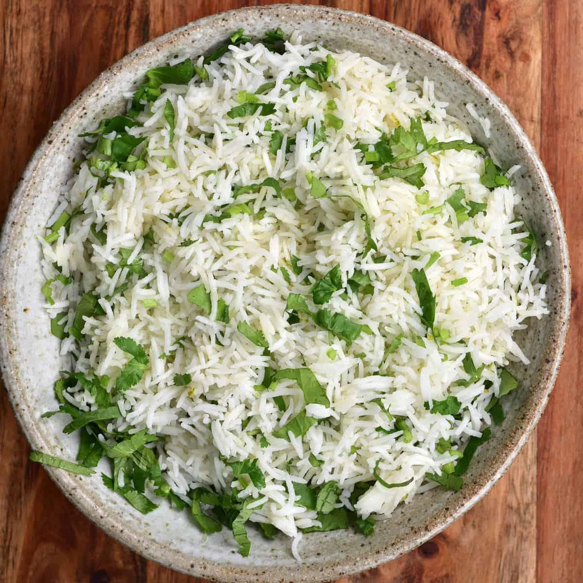 A bowl of basmati rice mixed with cilantro