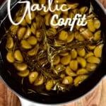 Garlic confit in a large pan