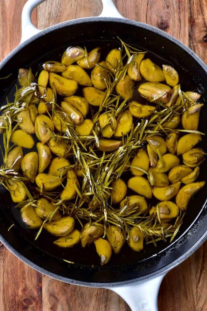 Garlic confit in a pan