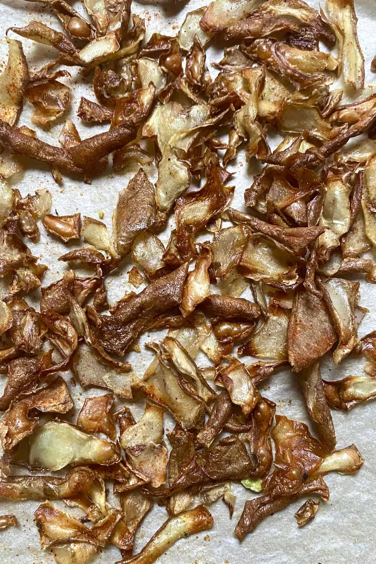 Potato peel chips on a flat surface