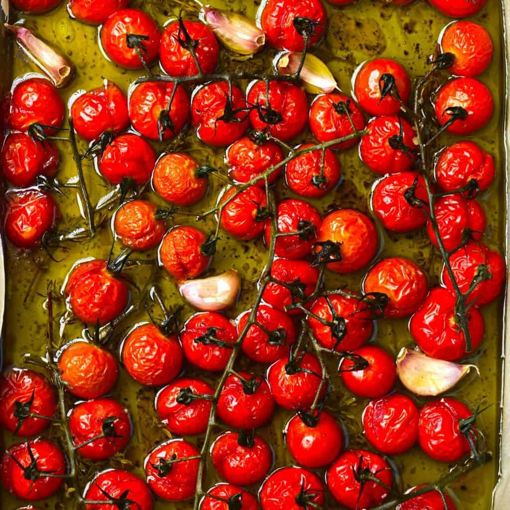 Tomato confit with garlic still in a baking tray