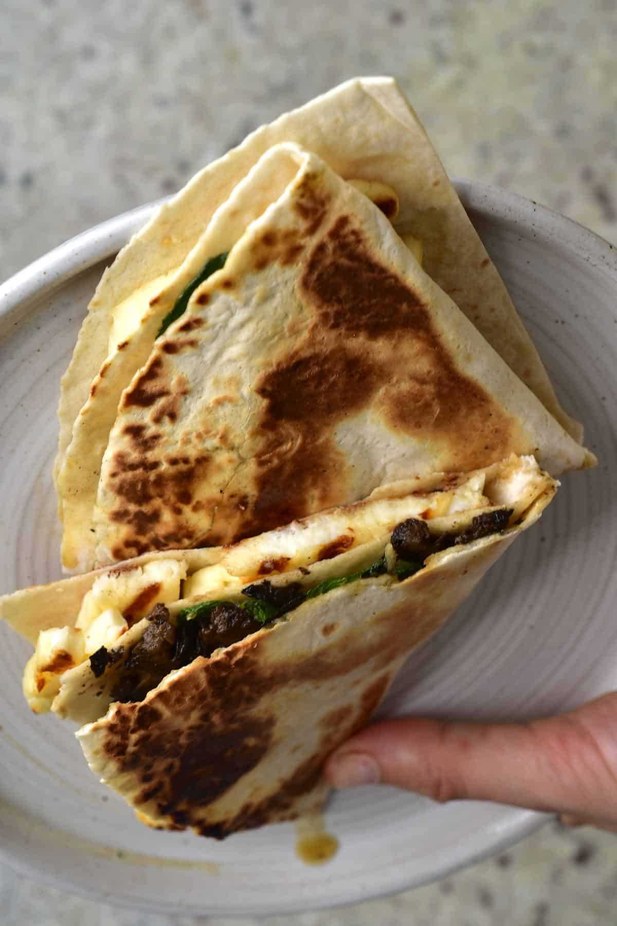 Folded toasted tortilla with halloumi