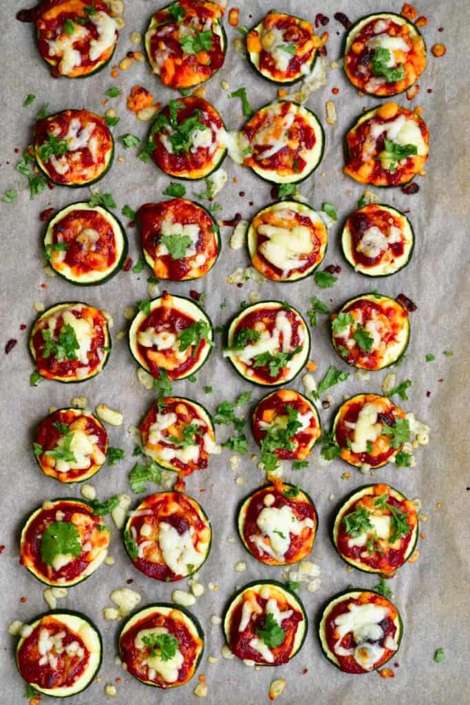 Baked Zucchini pizza bites on parchment paper