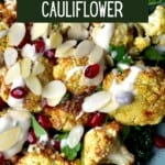 Air fryer roasted cauliflower topped with pomegranate seeds and flaked almonds