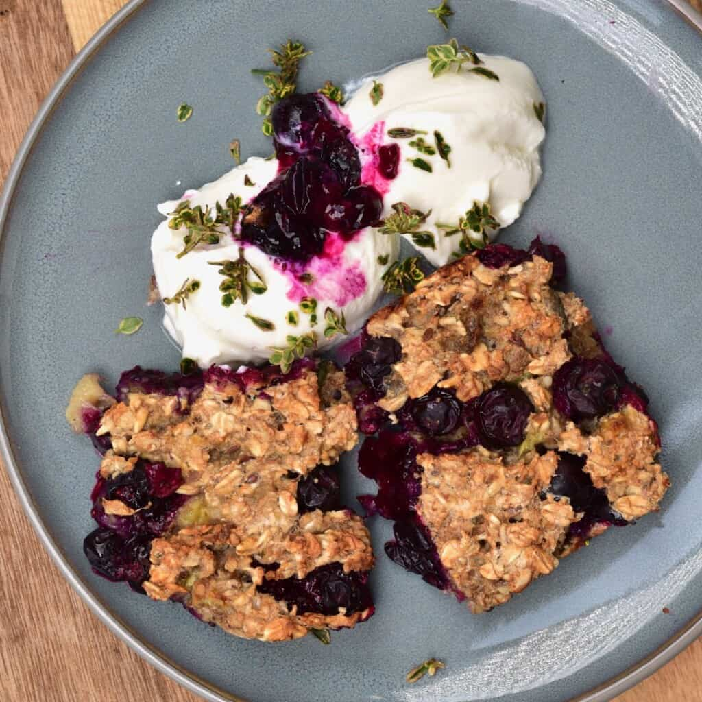 Baked blueberry oats served with yogurt