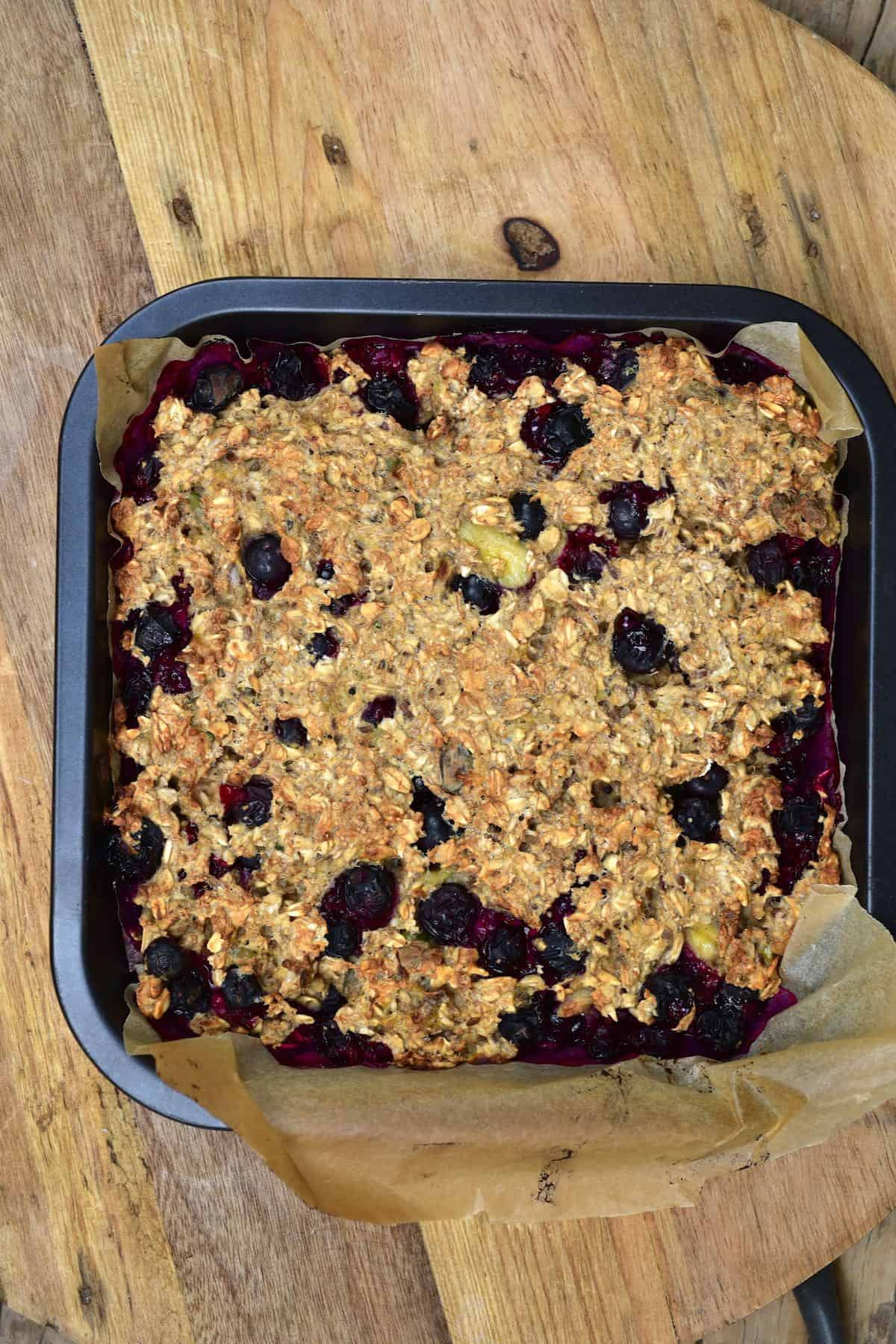 Baked blueberry oats in a baking tray