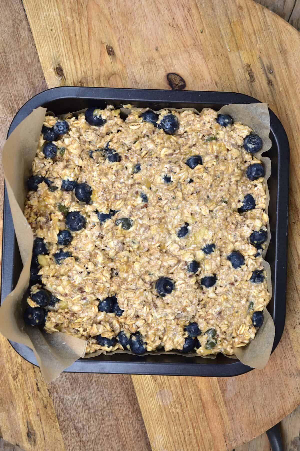 Blueberry oat mix put in a baking tray