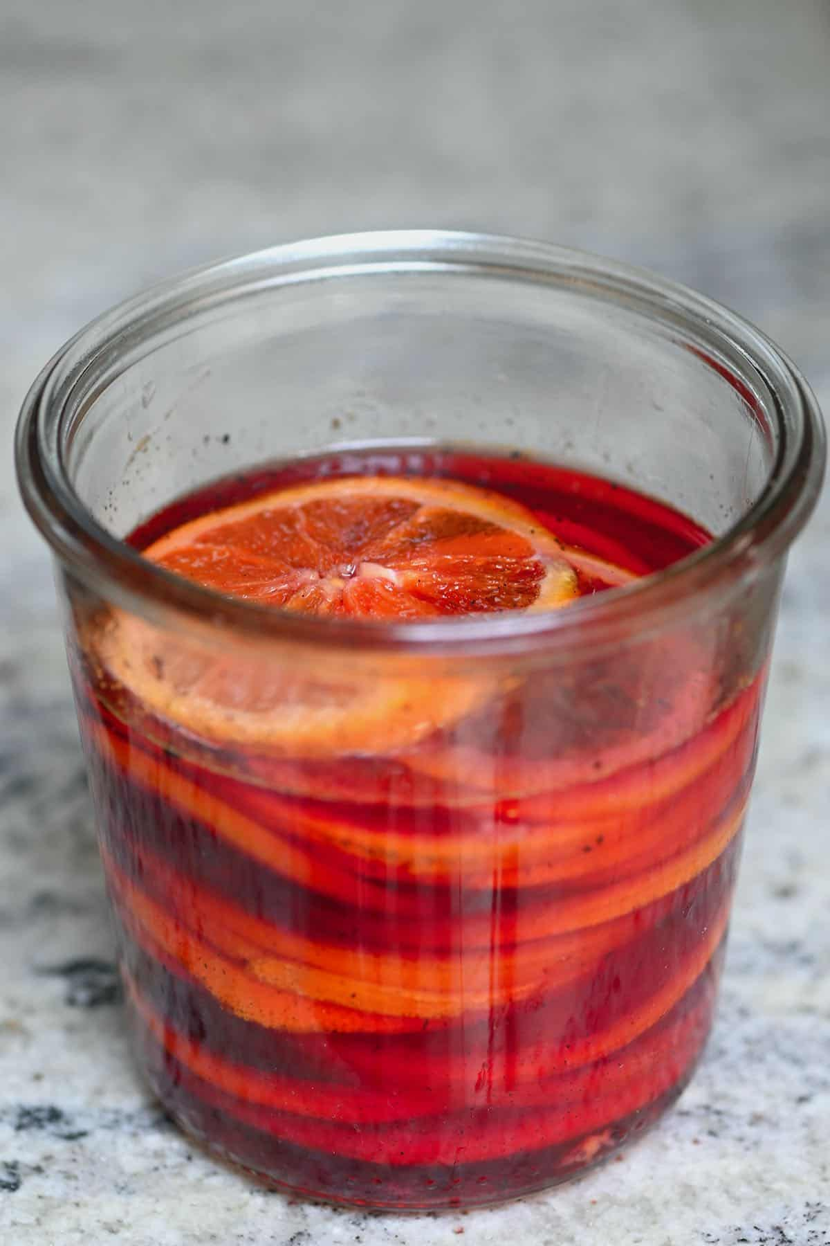Candied orange slices in a jar with syrup