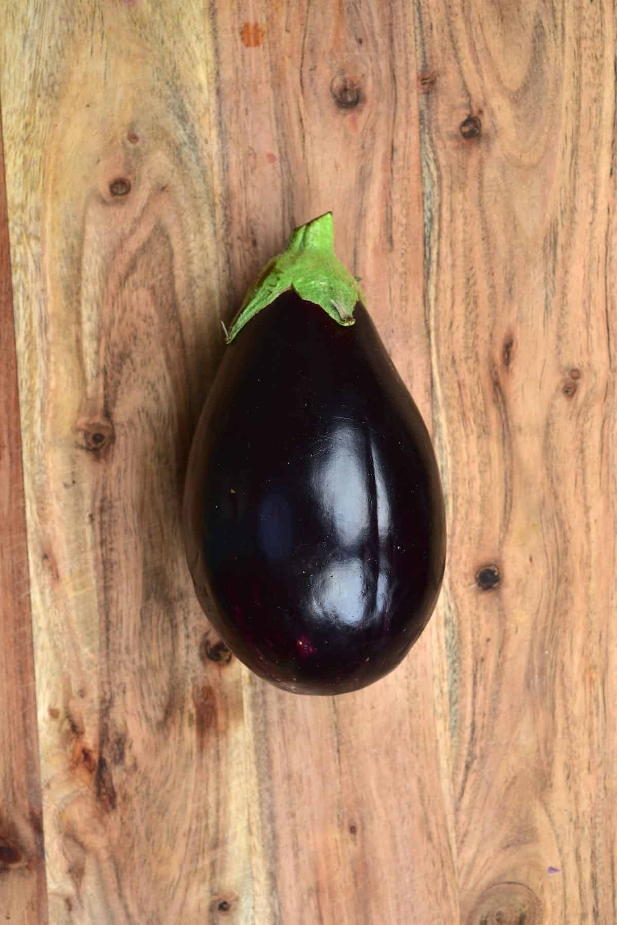 An eggplant on a chopping board