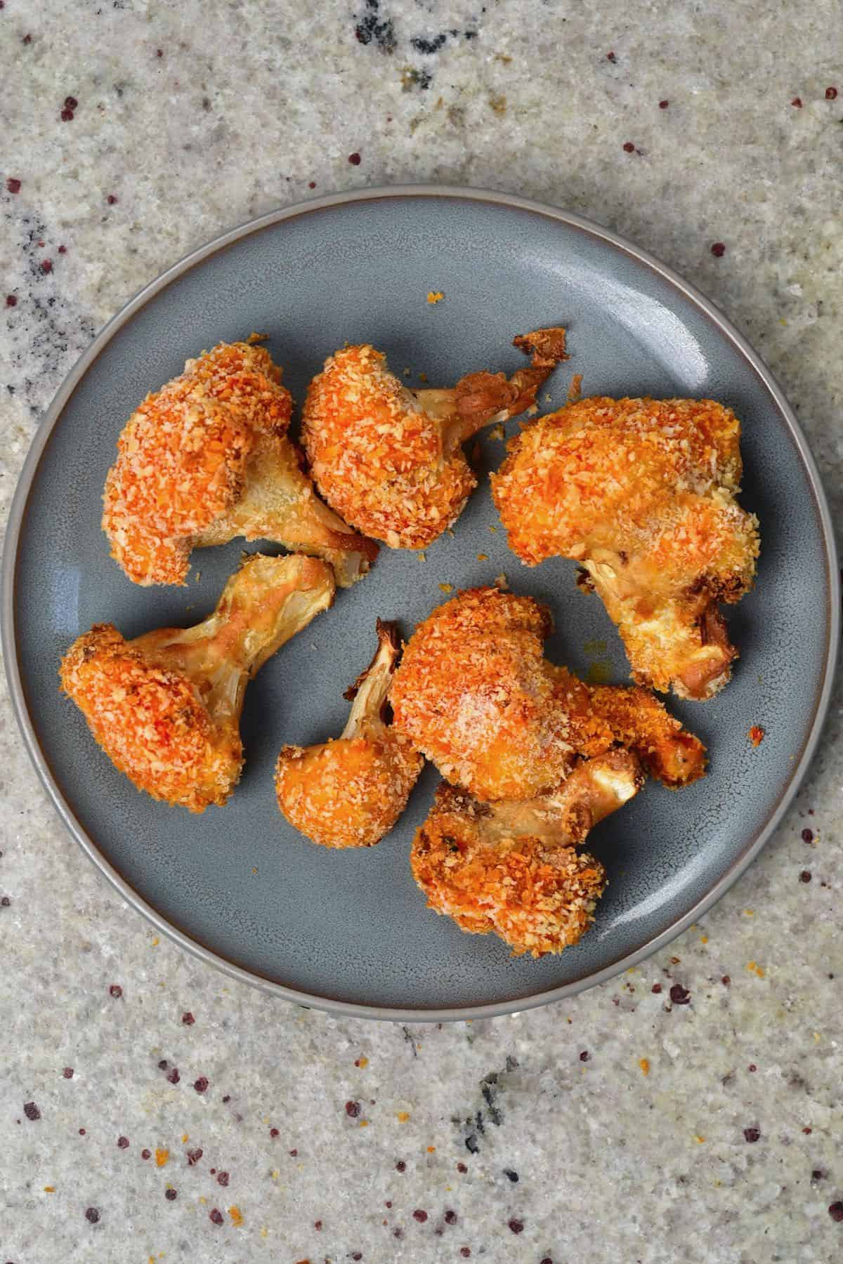 A plate with 7 baked breaded cauliflower wings