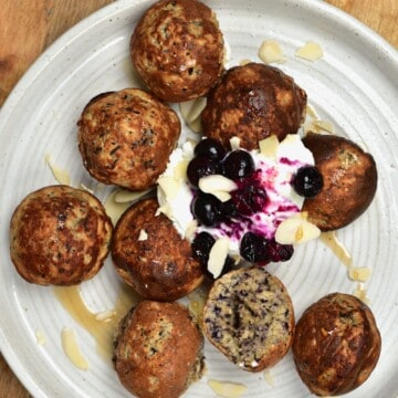 Blueberry Mini Pancake Balls served with yogurt in a plate