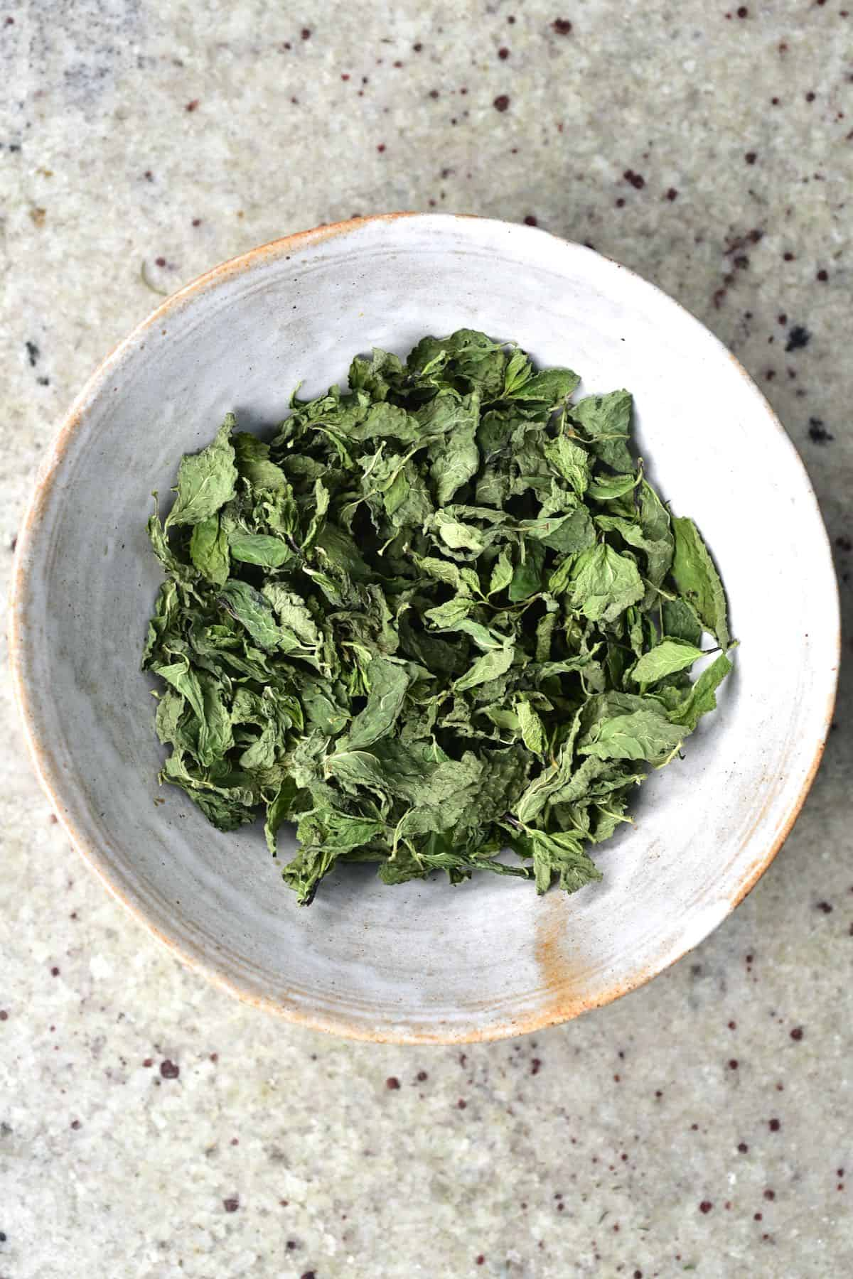 Dried mint leaves in a bowl