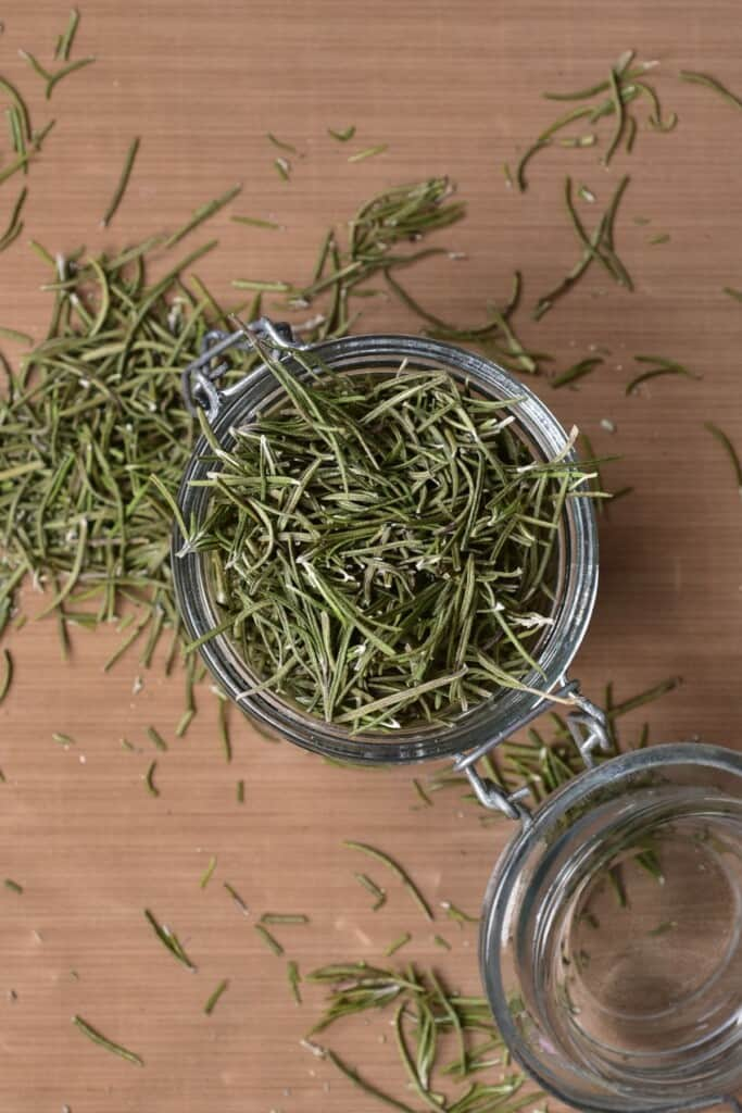 A jar filled with dried rosemary