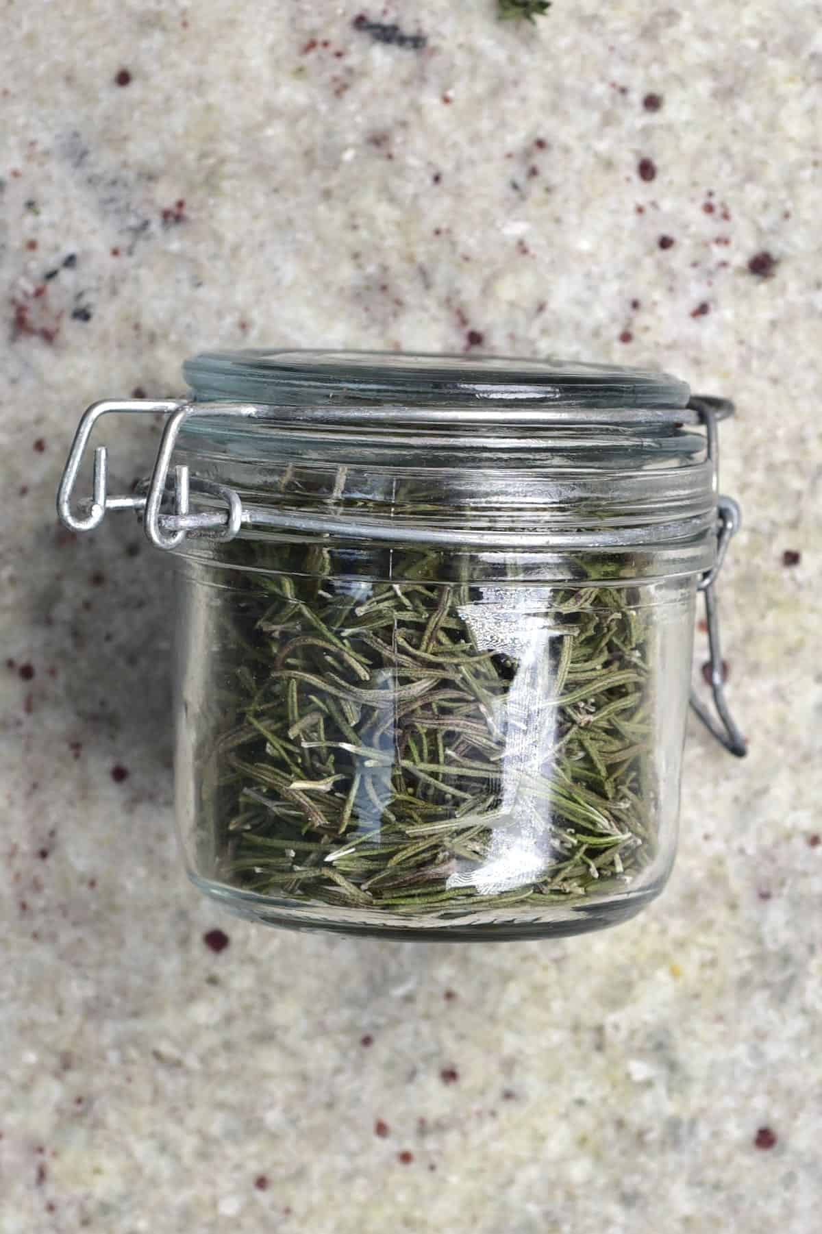 A jar with dried rosemary