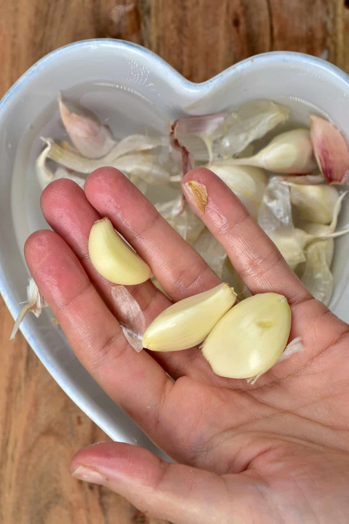 Garlic coming out of a bowl with hot water