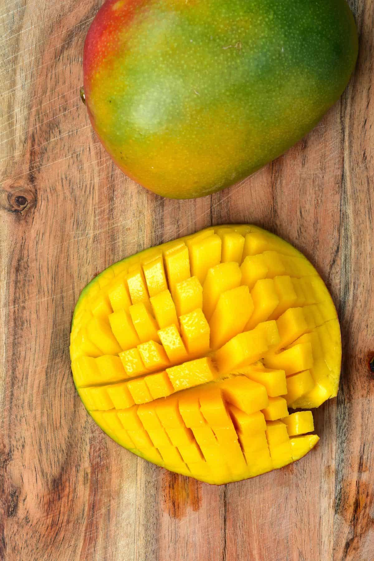 Diced mango on a wooden board