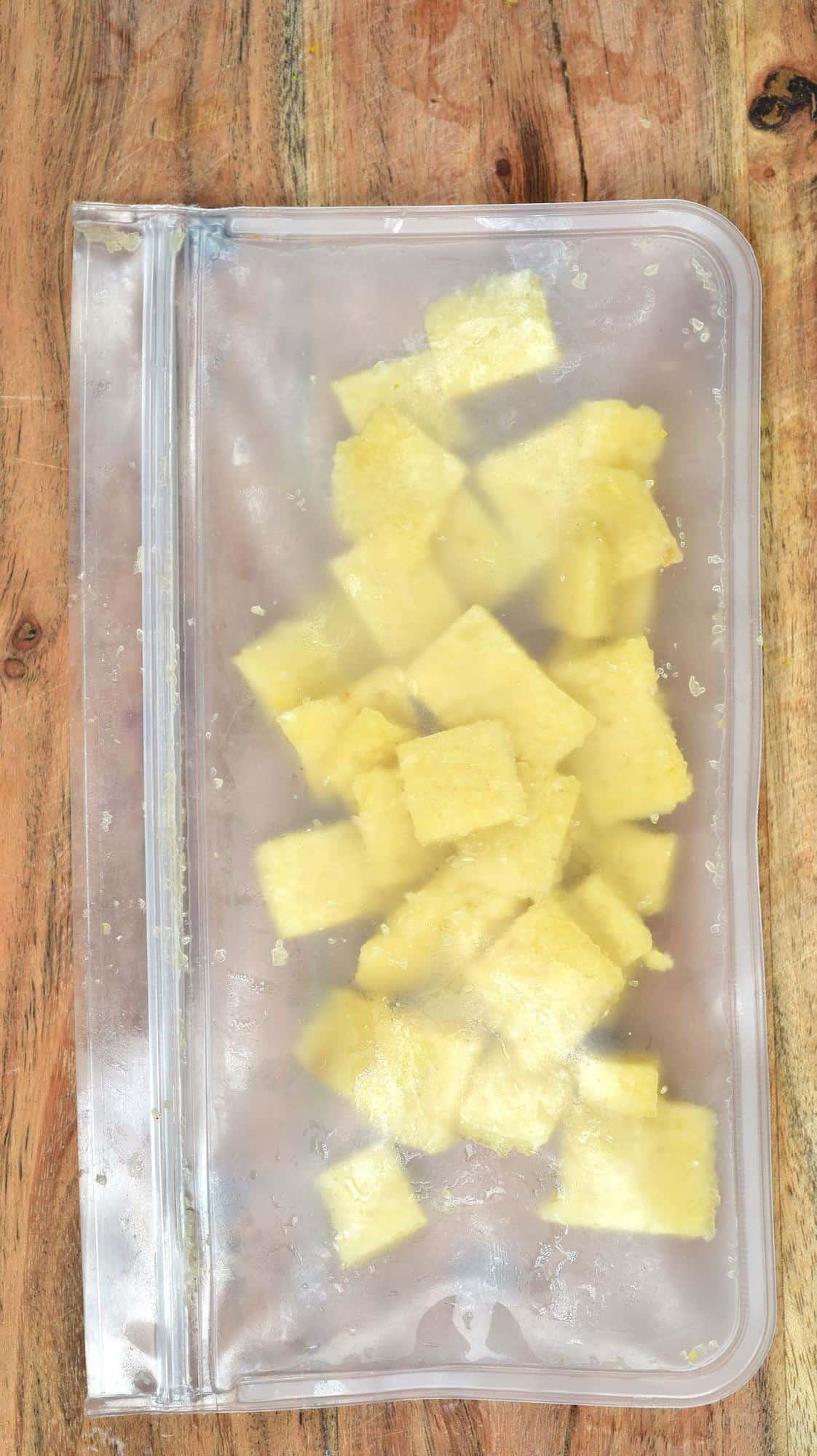 Frozen garlic cubes in a freezer bag