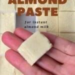 A frozen almond butter cube in a hand