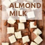 Frozen almond butter cubes and some almonds around them
