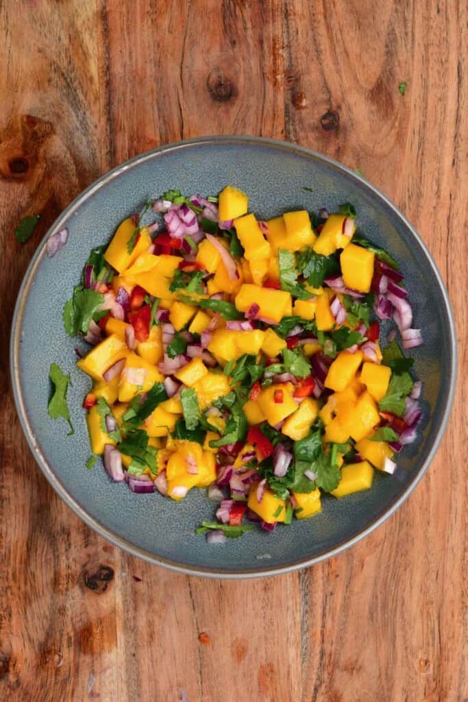 A bowl with mango and cilantro salsa