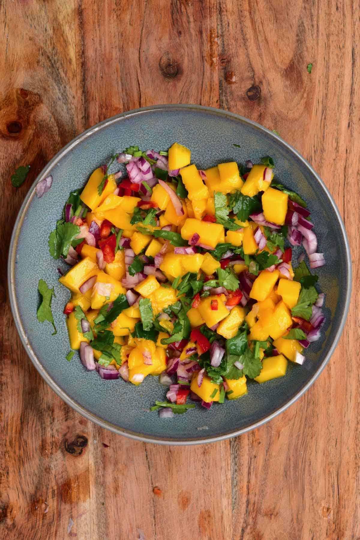 A bowl with mango and cilantro salsa