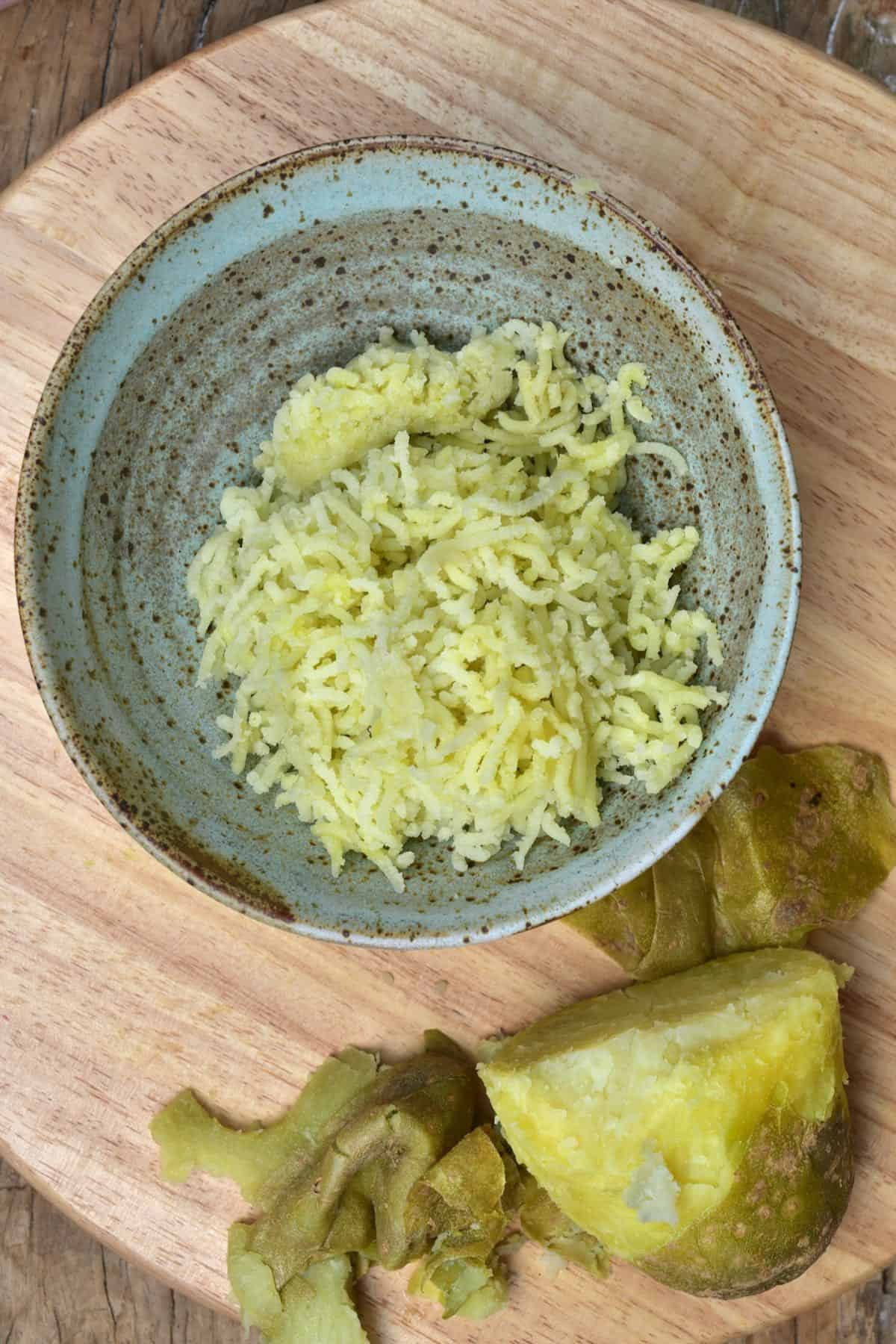 Grated potato in a bowl