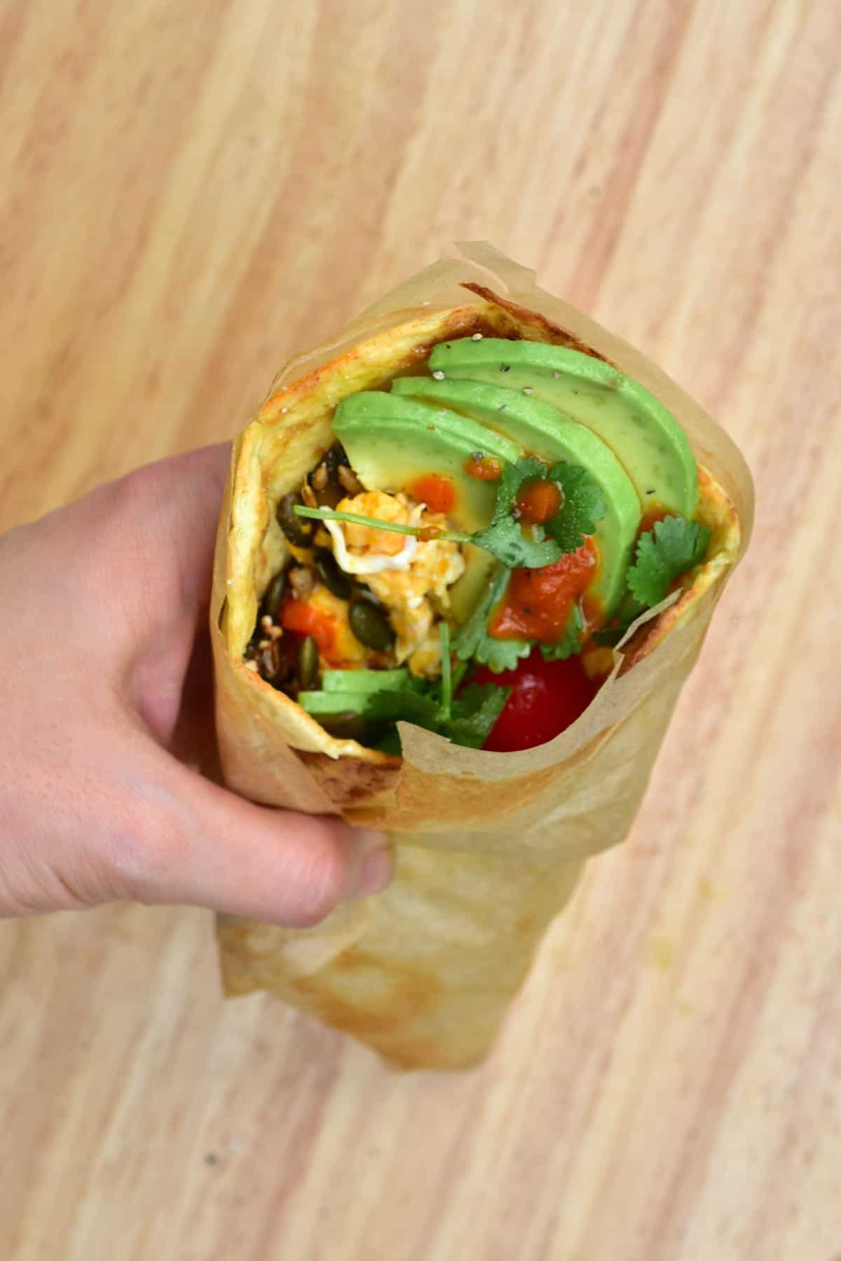 Potato flatbread wrapped with avocado and other ingredients