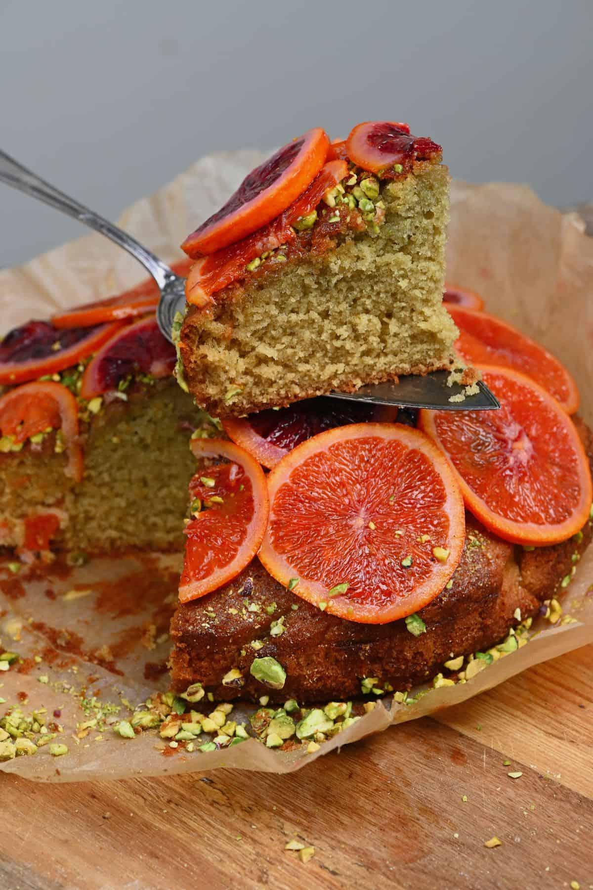 A slice of orange cake on top of the cake