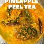 Pineapple skin and cinnamon in a large pot with pineapple tea