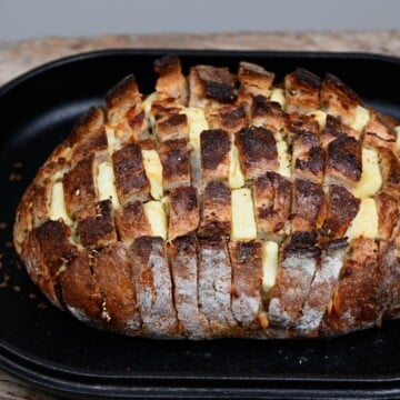 Pull-apart cheese sourdough bread in a baking tray