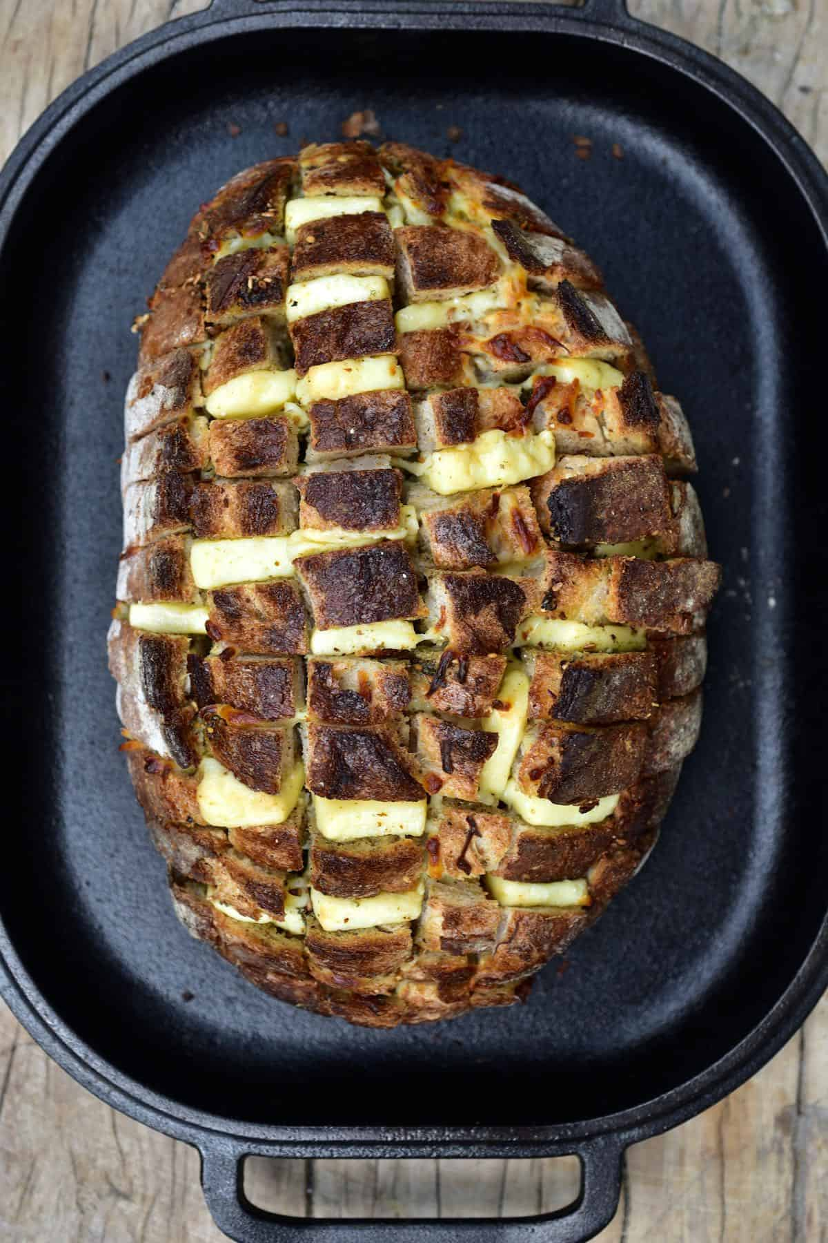 Pull apart cheese sourdough bread in an oven dish