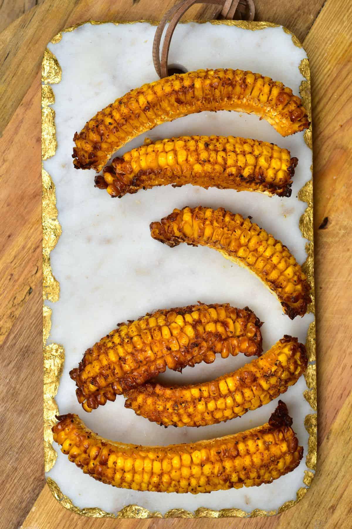 Baked corn ribs on a chopping board