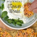 Turkish pide bread dipped in labneh with mint