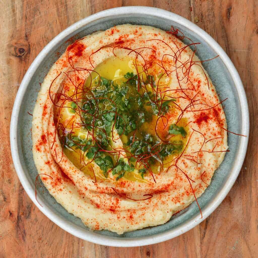 White bean roasted garlic dip served in a plate
