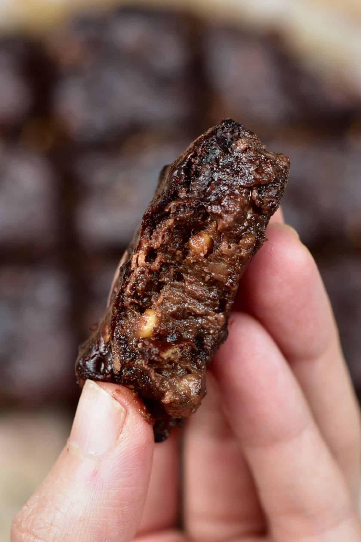 A close up of banana brownies held in a hand