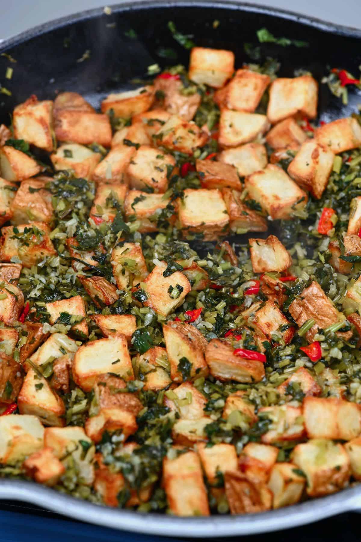 Batata harrah with sauteed herbs