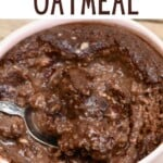 A spoon dipped in chocolate baked oats