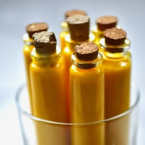 Small bottles with turmeric juice