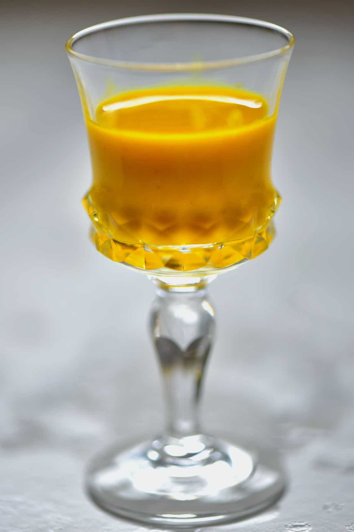 A small glass with turmeric juice