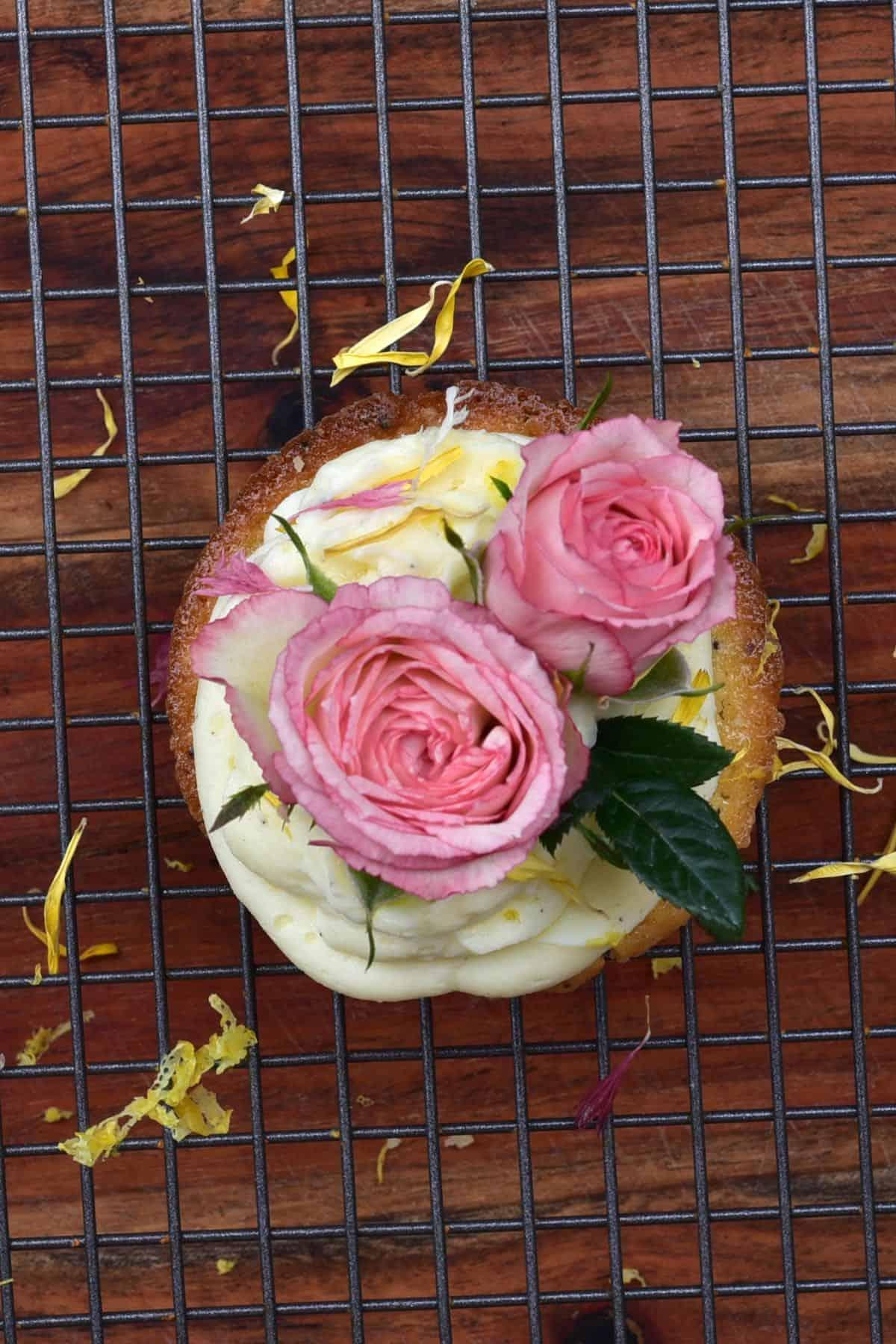 Top view of lemon cupcake with roses