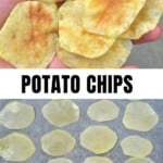 Potato chips in a hand and potato slices on parchment paper