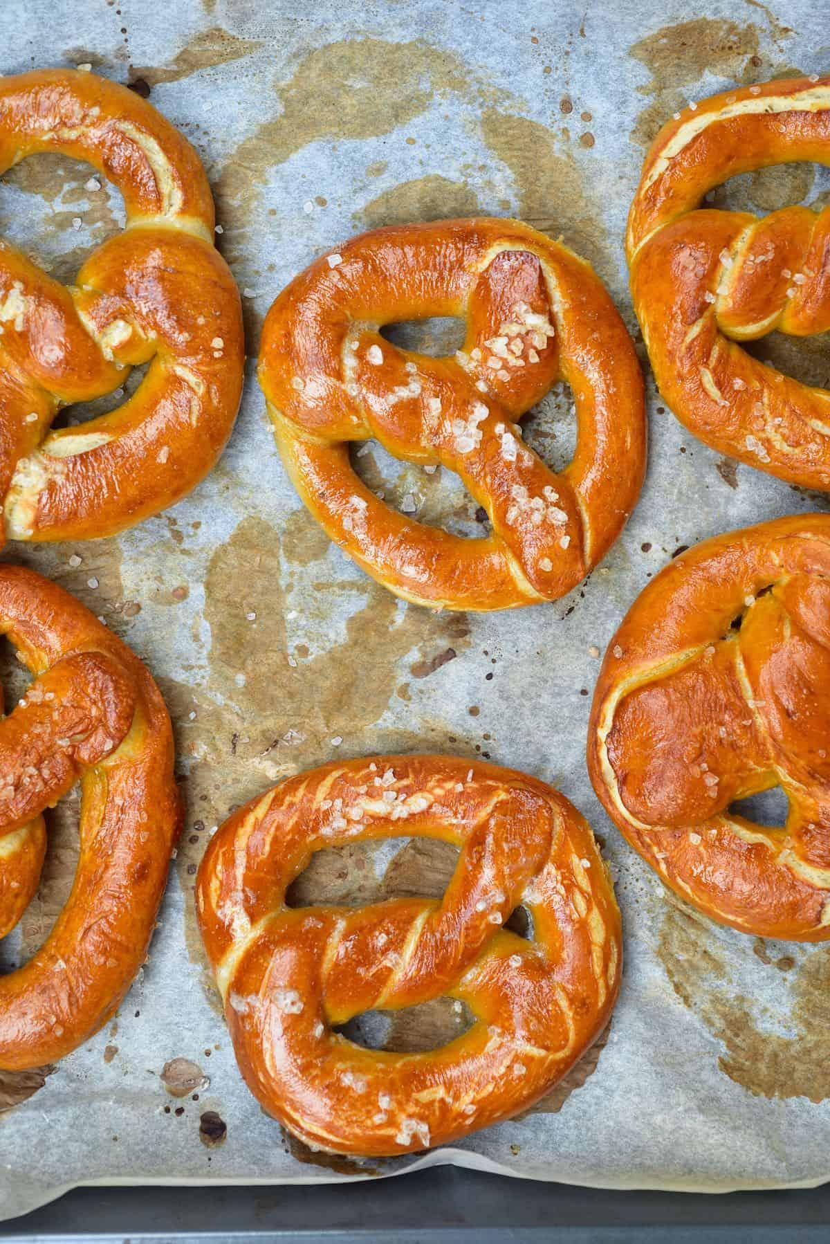 Freshly baked pretzels on a baking tray