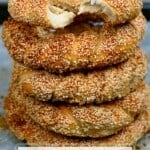 Five simit breads stacked on top of each other