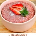 Strawberry baked oats topped with a strawberry