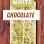 A bar of white chocolate with pistachio nuts