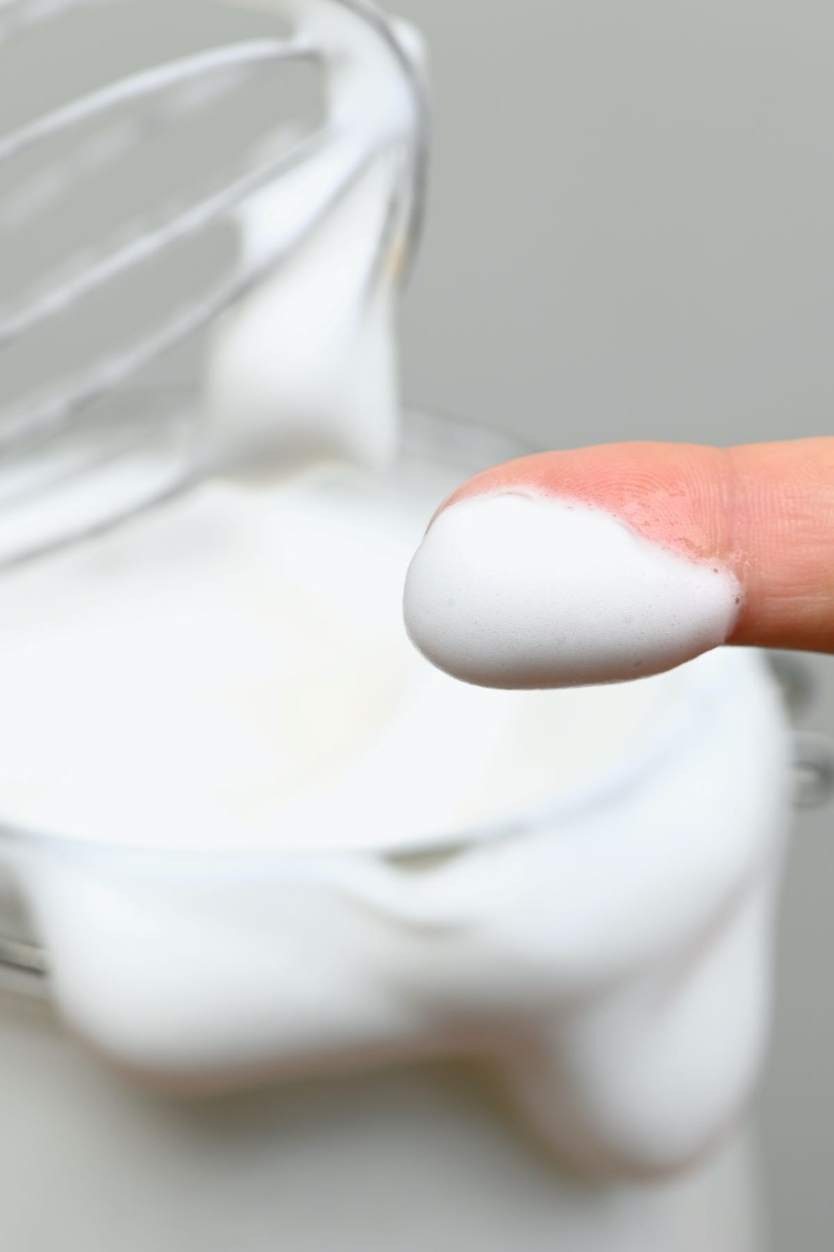 A finger dipped in aquafaba