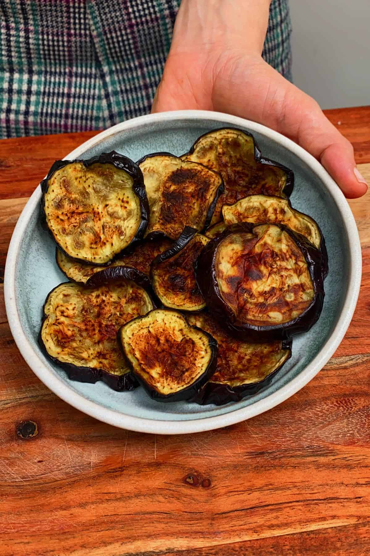 Grilled eggplant slices in a late