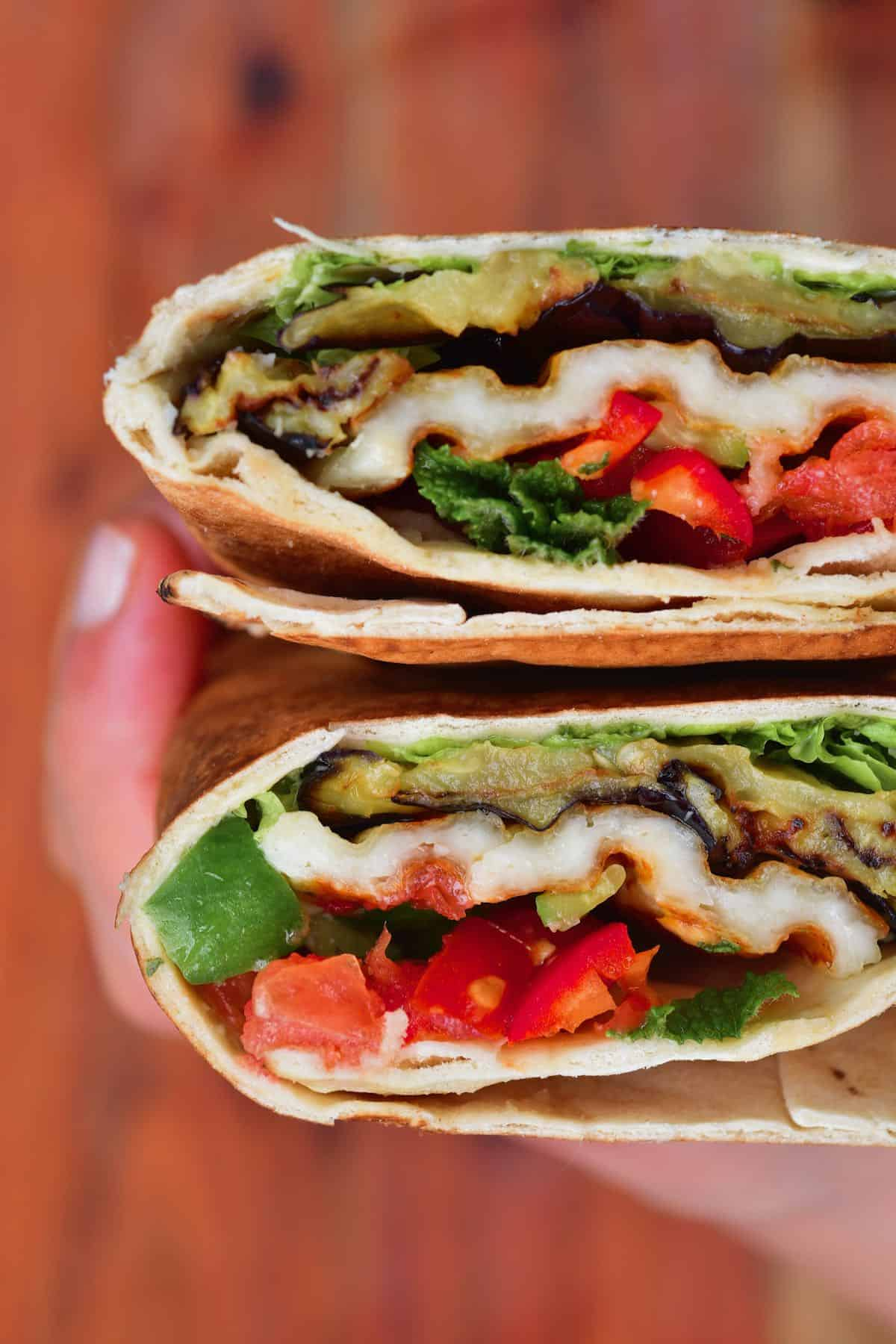 Two halves of an eggplant wrap