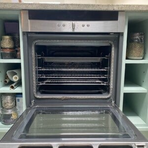 A clean open oven with all of its wracks arranged