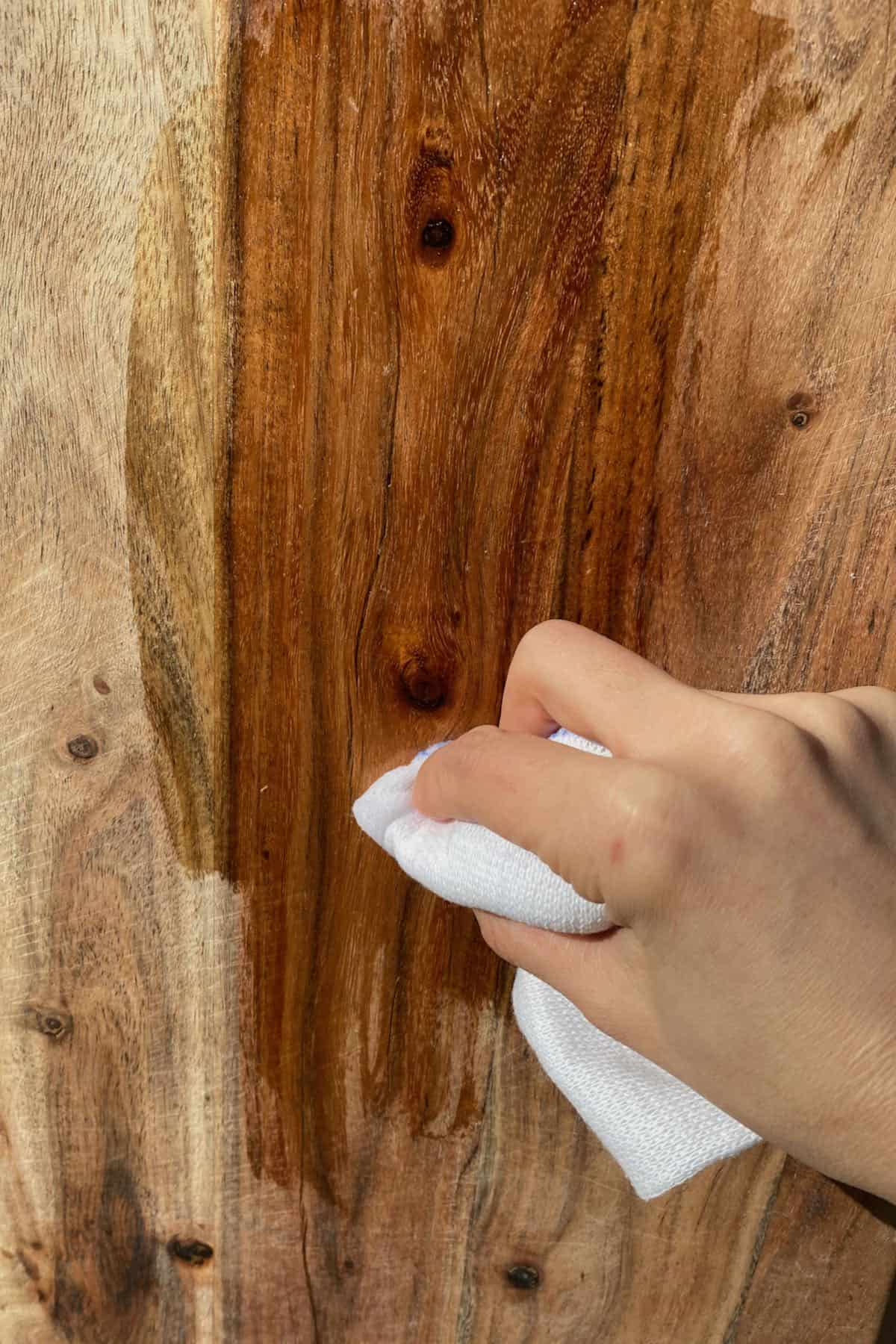 Applying mineral oil on a wooden board